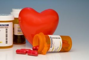 cholesterol medication pill bottles