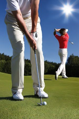 Image of a men playing golf