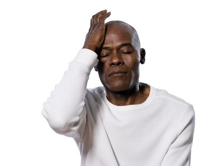 A man with migraine pain