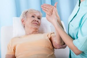 woman receiving treatment for osteoporosis