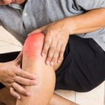 a person suffering from a joint pain
