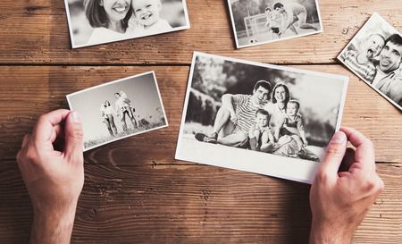 scattered photographs with pictures of family