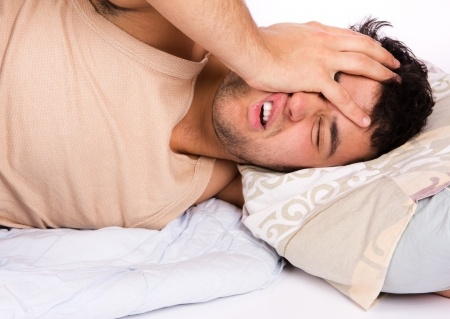 Image of a man trying to sleep with back pain